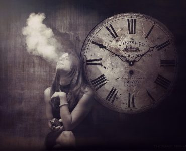 Woman exhaling a cloud of vapor