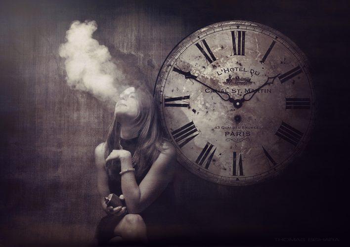 Woman exhaling a cloud of vapor